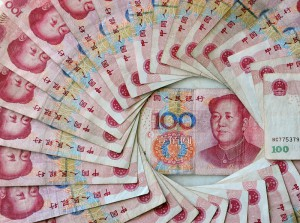 This March 17, 2010 illustration in Beijing shows China's 100 Yuan, or Renminbi, notes, the largest denomination in Chinese currency. The World Bank has urged China to let its currency rise to contain inflation and stop the economy overheating, predicting that growth will gallop ahead at 9.5 percent this year. China is facing growing international pressure, particularly from the US, to let the yuan appreciate but Chinese Premier Wen Jiabao's insisted over the weekend that Beijing would resist any foreign pressure for a stronger yuan, currently pegged within a narrow range at about 6.8 to the USD. AFP PHOTO/Frederic J. BROWN (Photo credit should read FREDERIC J. BROWN/AFP/Getty Images)