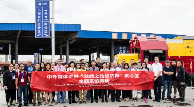 Foreign journalists visit Xinjiang series(1)-China Railway Express Links You and Me